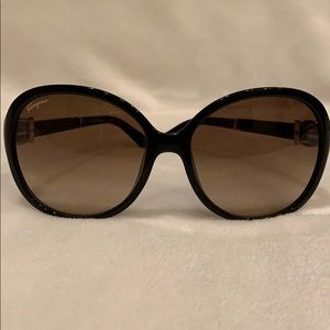 Salvatore Ferragamo sunglasses good small scratch.